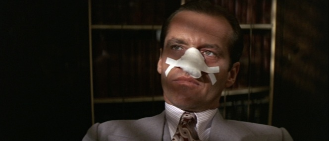 Gittes dials down the color for a decidedly less cheery day at work.