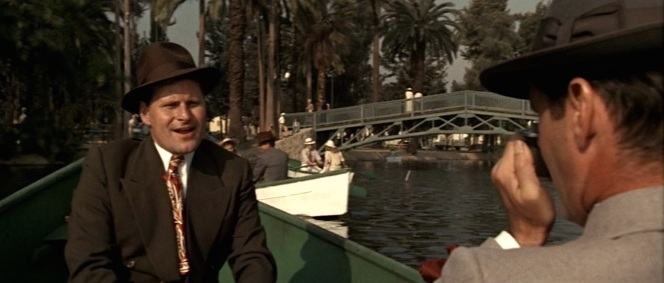 Gittes finds an uninspiring subject in the form of his assistant Duffy (Bruce Glover). Of far more professional interest is the sight of Hollis Mulwray rowing alongside them with an unidentified young woman...