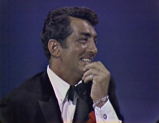 Dino flashes his accessories and cuffs during an early episode of The Dean Martin Show.