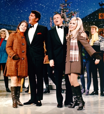 Dean Martin and his daughter Claudia singing alongside Frank Sinatra and his daughter Nancy on The Dean Martin Show's 1967 Christmas special.