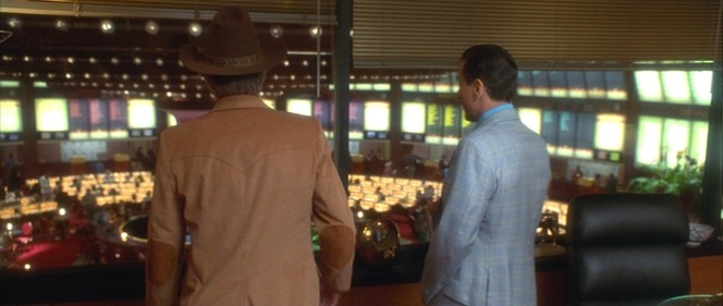 "Webb and Rothstein look out over the latter's Tangiers ""casino empire."""