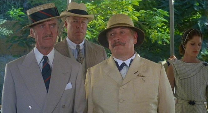"Though Colonel Race, Andrew Pennington (George Kennedy), and Hercule Poirot (Peter Ustinov) are all adequately dressed for a sightseeing tour in late 1930s Egypt, only Colonel Race's ensemble - straw boater aside - is truly timeless. Also note Lois Chiles looking pensive over Peter Ustinov's left shoulder; the following year, she would star as ""Bond girl"" Dr. Holly Goodhead in Moonraker."