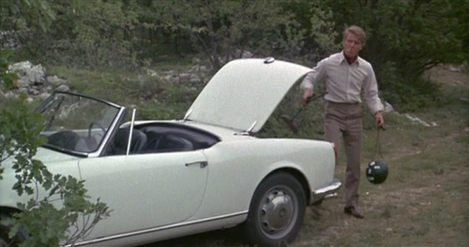 The Giulietta Spider's 10.2 cubic feet of trunk space is all The Jackal needs for his compact custom rifle and melon.