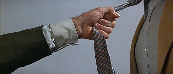 While Sandor gripping Bond's tie may have saved his life (at first), the tie's own lifespan would have been drastically shortened by this savage treatment.