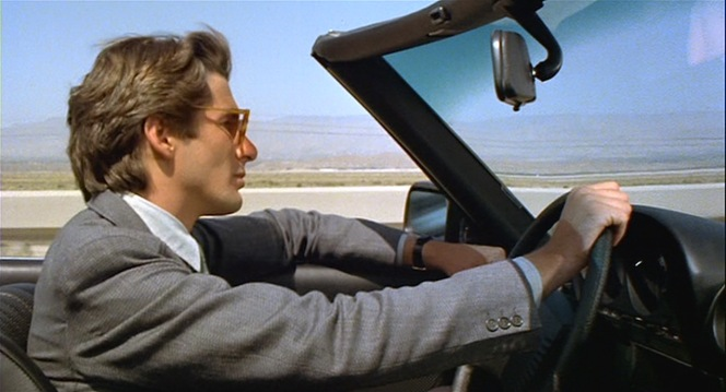 Julian cruises through southern California in his Mercedes convertible.