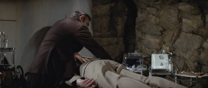 Dr. Bond administers to his patient.