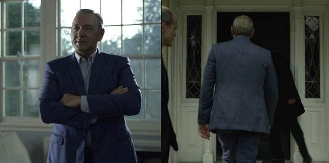 Underwood's blue-gray suit reflects varying colors depending on his surrounding light.