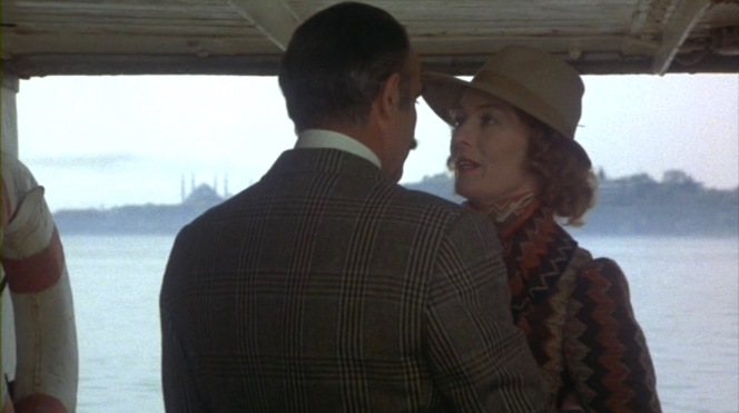 Colonel Arbuthnot's plaid on display while embracing Mary Debenham (Vanessa Redgrave).