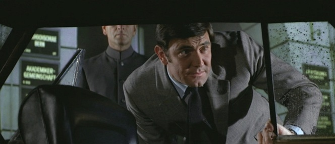 Lazenby isn't the only one channeling early Connery films here; the chauffeur behind him appears to have taken some style points from Doctor No.