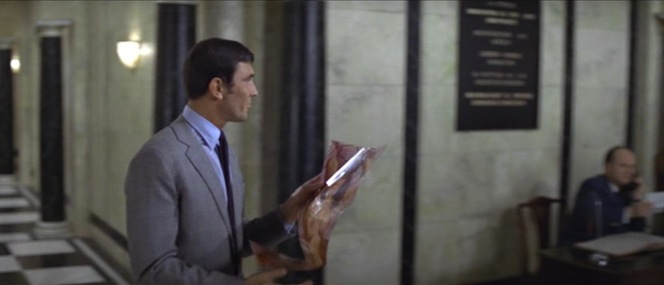 Bond gives audiences an R-rated glimpse at Lorrie as he heads for the elevator. Should you be so inclined, you can find the very centerfold that 007 was peeping here.