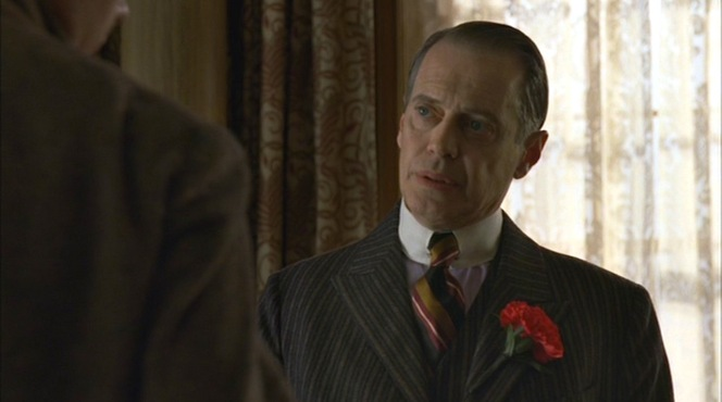 """Broadway Limited"" (episode 1.03): Nucky wears a lavender shirt with a multi-striped tie for a day at the office."