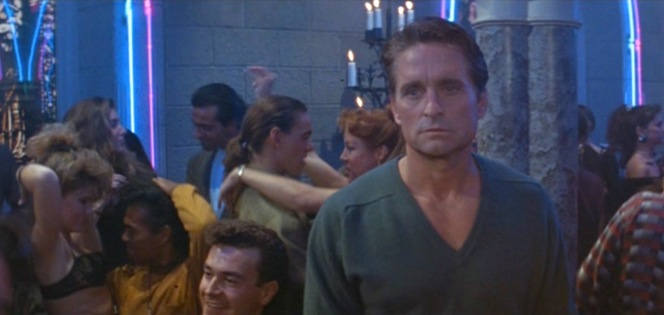 Though a deep v-neck top with no undershirt is typically a bold choice best suited to only the most casual of situations, Nick Curran looks relatively conservative when compared to his fellow clubgoers (is that woman on the left just wearing a bra?)