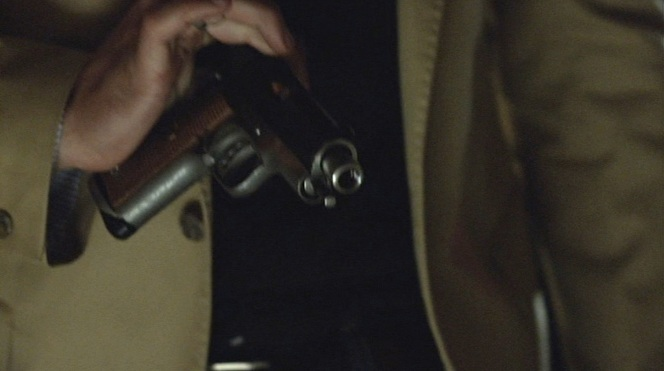 Raylan performs a one-handed brass check on his subcompact Colt. Don't try this at home.
