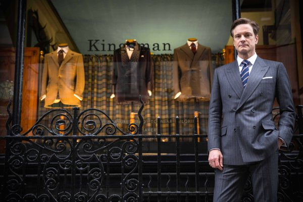 """Colin Firth, as Kingsman agent Harry Hart, stands in front of the H. Huntsman & Sons tailor shop on Savile Row, """"redecorated"""" to suit the needs for filming Kingsman: The Secret Service in October 2013."""
