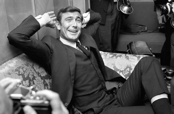 A beaming Lazenby grins for the cameras at London's The Dorchester hotel where he was officially announced as the new James Bond on October 7, 1968.