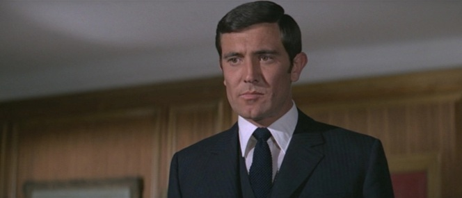 "Bond is understandably displeased when M forces him off of ""Operation Bedlam""."