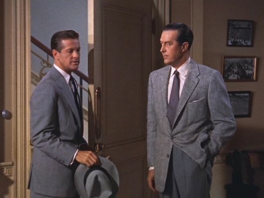 Both dressed in gray, Mark and Tony look considerably less vibrant than their first meeting earlier in the film.