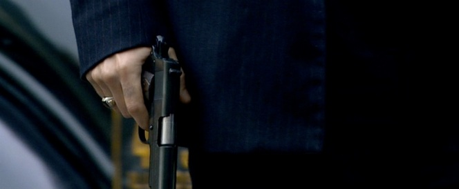 "Note the ""diamond"" walnut grips on Dillinger's 1911A1 (as well as the excessively long sleeves of his suit jacket.)"