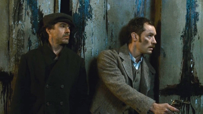 Also worthy of mention is Jude Law's fantastic era-designed brown herringbone tweed three-piece suit as Dr. Watson.