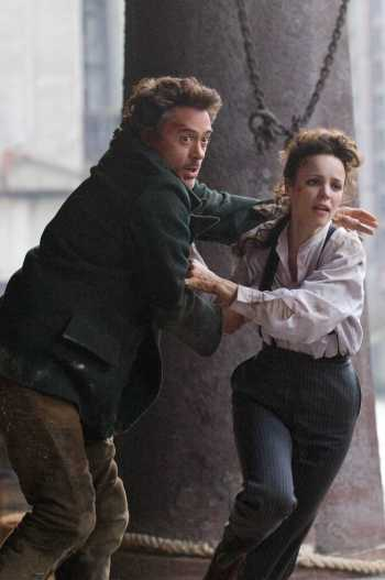 Robert Downey Jr. and Rachel McAdams in Sherlock Holmes (2009)