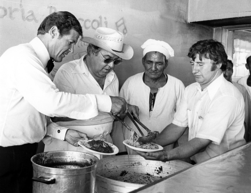Roger Moore ditched Bond's dinner jacket and grabbed a ladle when it came time to serve dinner for the crew.