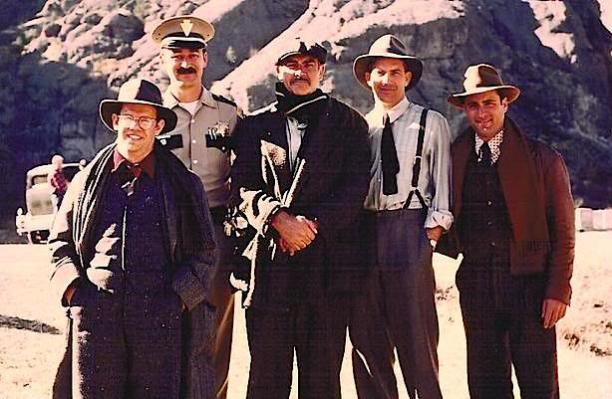 Behind the scenes images of some of the cast on location shows Costner in costume sans jacket and waistcoat.