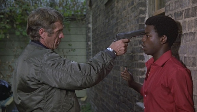 Thorson holds bail jumper Tommy Price at gunpoint in an early scene.