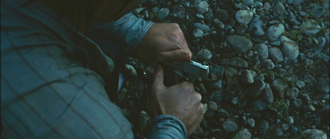 Llewelyn's uniquely striped shirt pattern in focus as he empties the chamber of his 1911.
