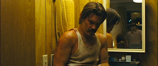 Llewelyn tends to his wounded shoulder.