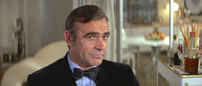 James Bond, confident that his bow tie won't mark him for inclusion in future Buzzfeed articles decrying 1970s fashion. (He obviously forgot about the short pink tie he had been wearing earlier...)