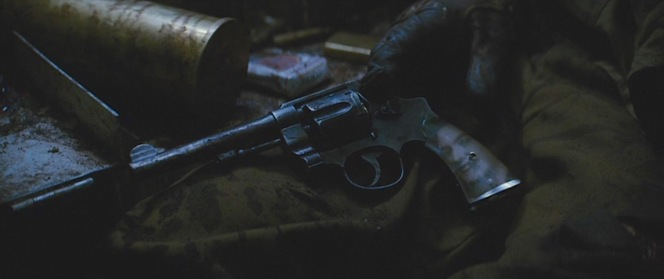 Wardaddy's Smith & Wesson M1917 with its custom grips. Note his Lucky Strike cigarettes in the background.