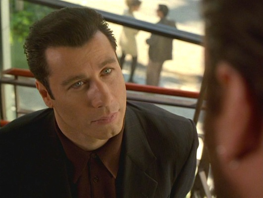 Chili encounters Bear (James Gandolfini), Bo Catlett's right-hand man. Notice the very subtly striped suiting, differentiating it from his usual solid black suit.