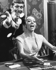 George Lazenby and Diana Rigg evidently having a bit of fun on the casino set.