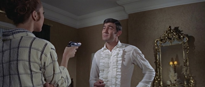 Lazenby lets the ruffles on his second shirt fly free after an evening of resting them unobtrusively beneath his dinner jacket where their true splendor could only be hinted at.