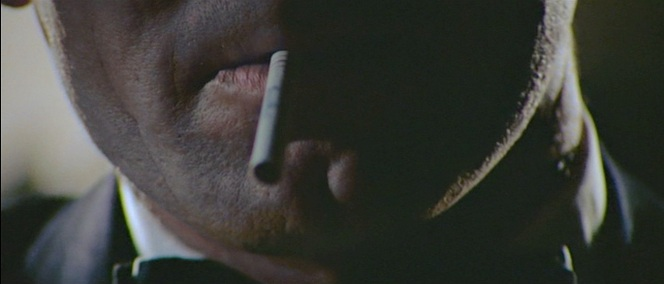 Can anyone better versed in tobacco lore than I identify the brand of cigarette Lazenby actually lights up as Bond? The blue printing at the midway point is certainly brand-suggestive.