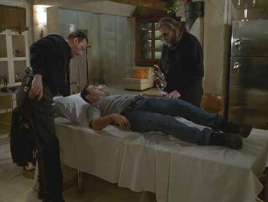 One of Sam's most badass moments finds him laying and bleeding on an operating table, calmly instructing his associate Vincent on what needs to be done to extract the bullet from his side.