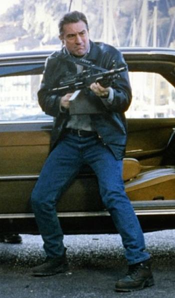 Robert De Niro as Sam in Ronin (1998), firing an FN Minimi in front of the gang's brown Mercedes-Benz 450SEL 6.9 sedan.