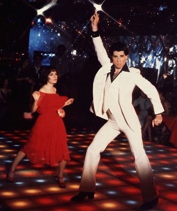 John Travolta and Karen Lynn Gorney in an iconic promotional image for Saturday Night Fever (1977).