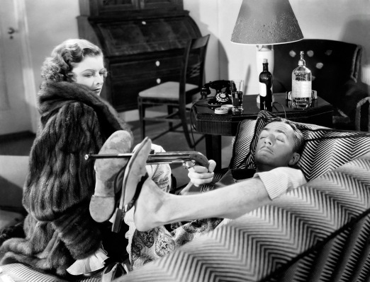 The Charles couple enjoys their Christmas gifts from each other: Nora in her mink coat from Nick, Nick playing with his air pistol from Nora.