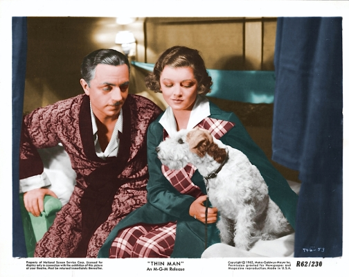 This 1934 lobby card illustrates Nick and Nora in shades of red and green: traditional Christmas colors that would have been appropriate for the film's holiday setting.