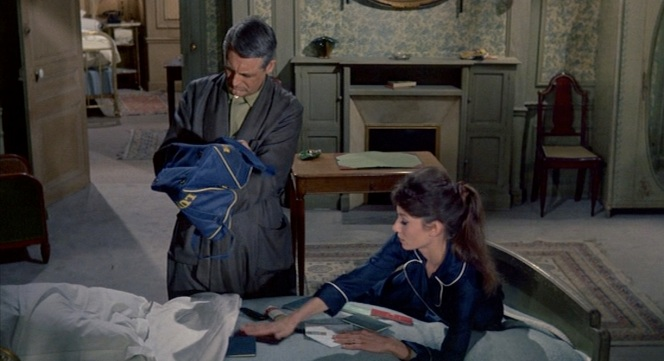 """Adam"" and Mrs. Lambert rummage through her late husband's Lufthansa bag for any potential clues."
