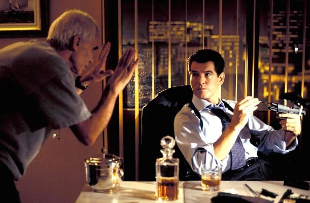 Production photo of director Lee Tamahori on set with Pierce Brosnan.