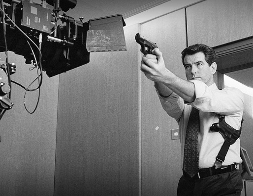 Production photo of Bond wielding his Walther P99. This photo by Greg Williams would be used on the cover of the paperback version of Williams' Bond on Set: The Making of Bond 20.