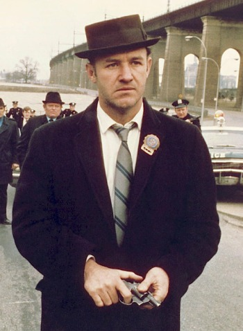 "Gene Hackman as ""Popeye"" Doyle in The French Connection (1971). Over his right shoulder is Eddie Egan, the real-life inspiration for the character."