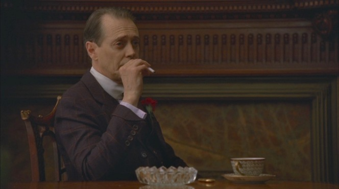 """Nucky flashes his unique turnback cuffs during an afternoon of cigarettes, coffee, and the Commodore's testimony about his near-fatal poisoning in """"A Return to Normalcy"""" (Episode 1.12)."""