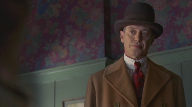 """""""Broadway Limited"""" (Episode 1.03): Judgement drips from Nucky's face as he confronts Gillian Darmody (Gretchen Mol) in the tarot-reading shop."""
