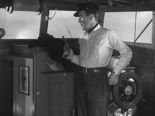 Harry draws his Colt Police Positive at the sound of a stowaway on board. In the book, the circumstances could have been even more dire for the blissfully unaware Eddie.