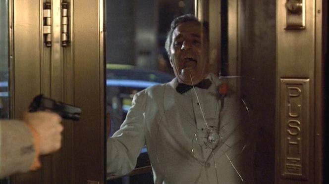 Don Cuneo, himself no sartorial slouch in a white dinner jacket, meets his end at the hands of Willi Cicci.