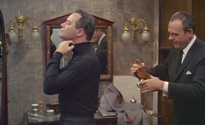 Stanley adjusts that which gives the turtleneck its name.