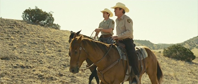 Deputy Wendell (Garret Dillahunt) accompanies Sheriff Ed Tom Bell on horseback.